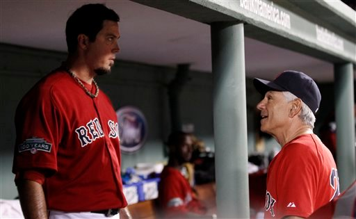 Boston Red Sox manager Bobby Valentine, right, talks with starting pitcher Josh Beckett in the dugout during the sixth inning of Friday'sl game against the Toronto Blue Jays at Fenway Park in Boston.