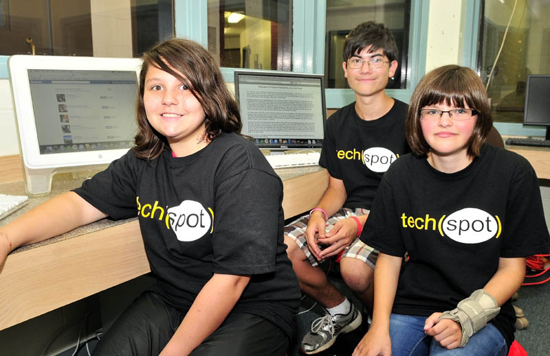 The Tech Spot members, from left, Hailee Buzzell, Micah Weatherford and Grace Pollis sit inside the grist mill in Skowhegan where they will help seniors learn to use computers.