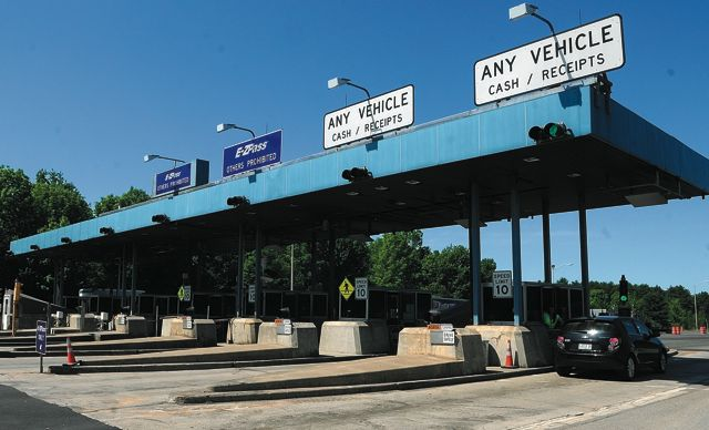 Staff photo by Joe Phelan Vehicles go through the Mile 101 toll plaza on the Maine Turnpike (Interstate 95) on Friday in West Gardiner.