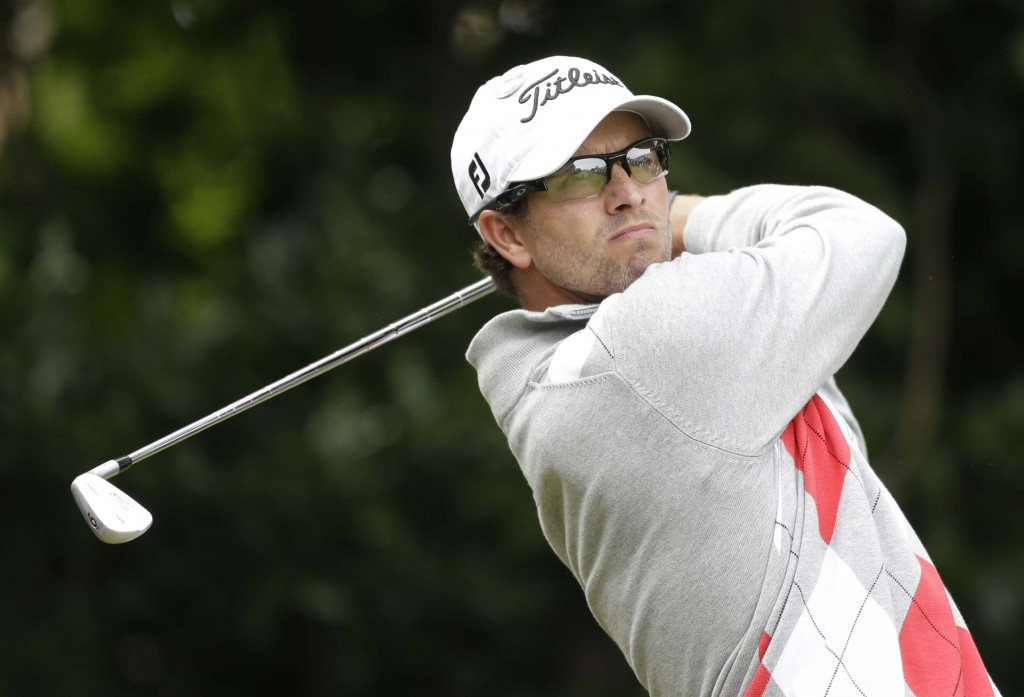 Adam Scott tees off today in the third round of the British Open at Royal Lytham & St Annes golf club in England. Scott takes a four-shot lead into Sunday's final round.