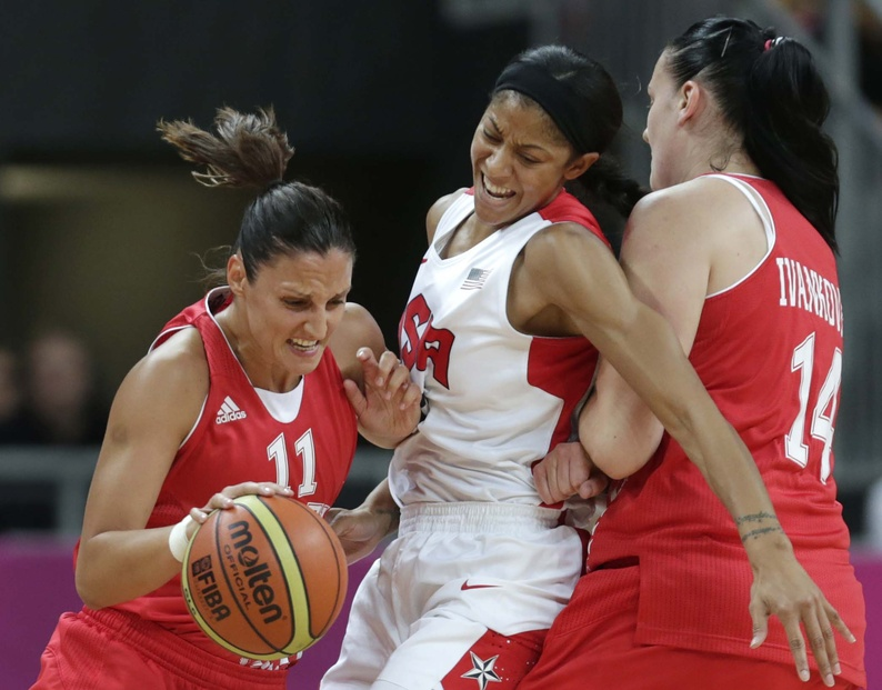 United States forward Candace Parker gets squeezed away from Croatia guard Ana Lelas by her teammate Luca Ivankovic during Saturday's game at 2012 Summer Olympics in London. The U.S. won, 81-56.
