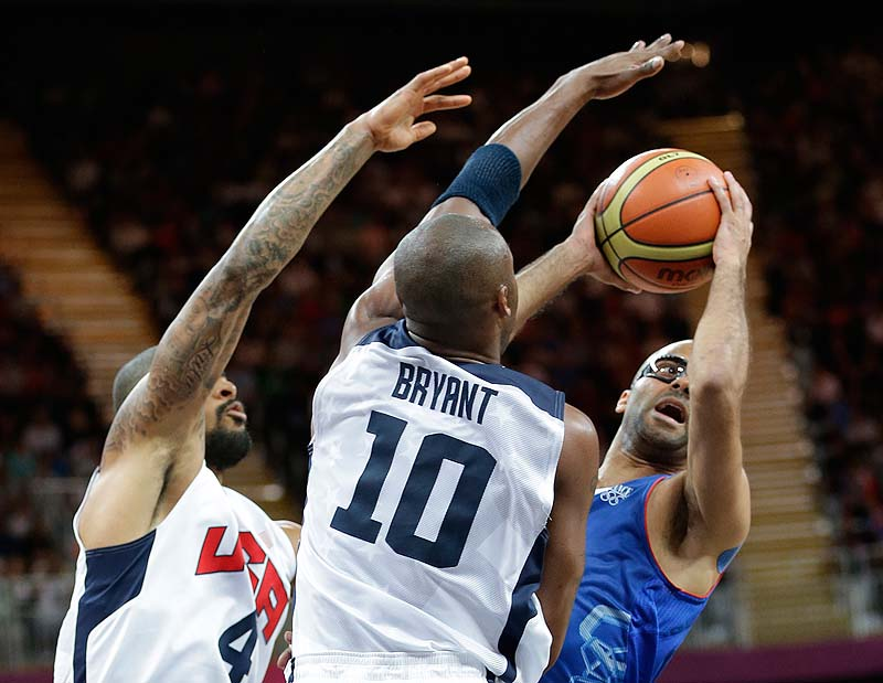 Tony Parker of France looks to shoot against USA's Tyson Chandler, left, and Kobe Bryant during the first half Sunday at the 2012 Summer Olympics. The US won, 98-71.