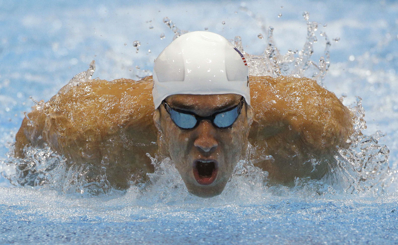Michael Phelps of the US competes in a heat of the men's 400-meter individual medley at the 2012 Summer Olympics on Saturday. 2012 London Olympic Games Summer Olympic games Olympic games Spo