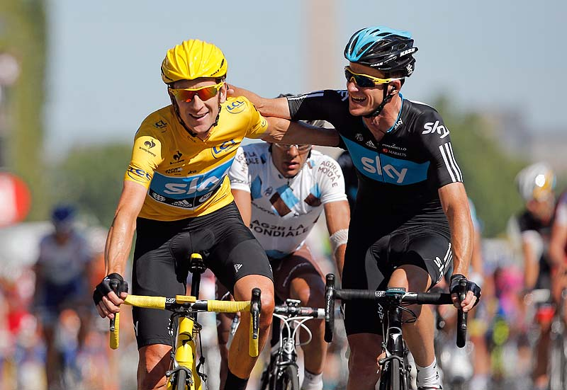 Bradley Wiggins, winner of the 2012 Tour de France, is congratulated by Michael Rogers of Australia after crossing the line of the 20th stage of the race today in Paris. He is the first Briton to win the race,