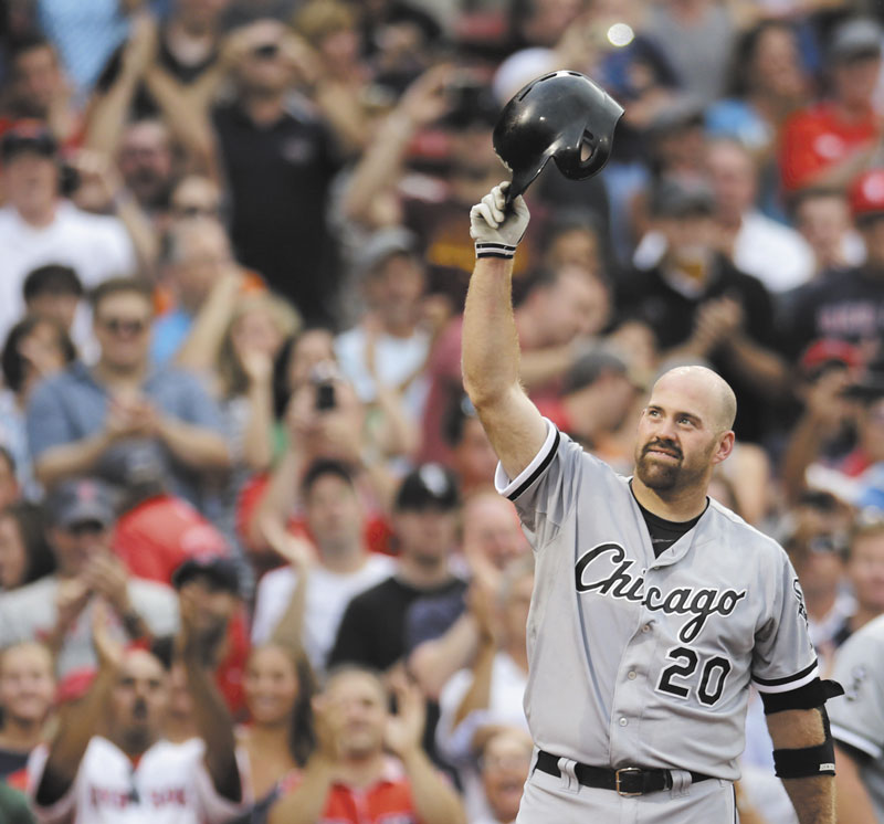 THANK YOU: Chicago White Sox third baseman Kevin Youkilis tips his batting helmet to fans as he receives a standing ovation during the first inning Monday at Fenway Park in Boston. Youkilis returned to Fenway, where he was a member of the 2004 and 2007 World Series Champion teams, for the first time since being traded.