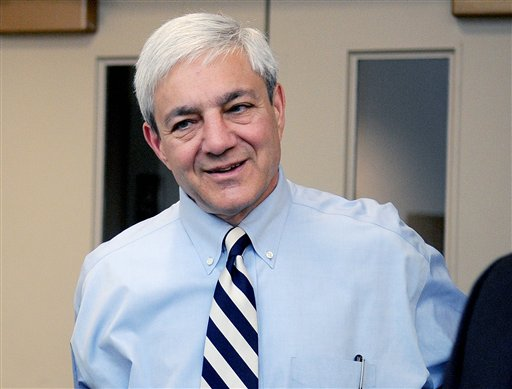 """In this July 12, 2012, photo, Penn State President Graham Spanier arrives at the University Park Airport in State College, Pa. Spanier and his lawyers attacked the university-backed report on the Jerry Sandusky sex abuse scandal on Wednesday, Aug. 22, 2012, in Philadelphia, calling it a """"blundering and indefensible indictment"""" as they fired a pre-emptive strike while waiting to hear if he'll be charged in the case. (AP Photo/Centre Daily Times, Abby Drey) MANDATORY CREDIT; MAGS OUT"""