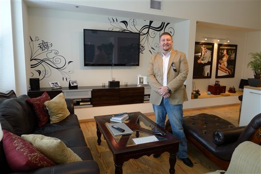 In this photo taken Aug. 10, 2012, James Griffin of Tampa stands in the living room of his condo in the city's downtown. Griffin is asking $1,250 a night to rent his home for the Republican National Convention. The only offers he's had so far are from protesters wanting to spend $100 a night. (AP Photo/Tamara Lush)