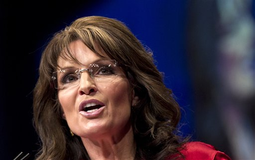 FILE - In this Feb. 11, 2012 file photo, Sarah Palin, the GOP candidate for vice-president in 2008, and former Alaska governor speaks in Washington. Sarah Palin and George W. Bush won�t be in Tampa. Hillary Rodham Clinton and Al Gore aren�t making the trip to Charlotte. And scores of other Republican and Democratic stars are taking a pass as their parties gather at every-four-years national conventions. The reasons are varied _ and political. (AP Photo/J. Scott Applewhite)