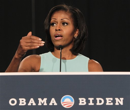 First lady Michelle Obama speaks to supporters during a campaign rally, Tuesday, July 24, 2012, in Westerville, Ohio. The first lady thanked volunteers for their hard work and spoke about what's at stake for Ohioans in this election. (AP Photo/Jay LaPrete)