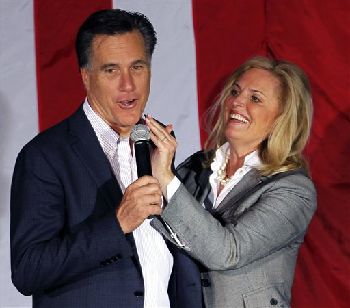 """FILE - In this March 5, 2012, file photo, Ann Romney, wife of Republican presidential candidate, former Massachusetts Gov. Mitt Romney, wipes lipstick off his face after kissing him at a campaign rally in Zanesville, Ohio. To the yearbook editors at the all-girl Kingswood School Davies' destiny seemed pretty obvious. """"The first lady,"""" the entry beside the stunning blond beauty's photo in the 1967 edition of """"Woodwinds"""" concluded. """"Quiet and soft spoken."""" The modern feminist movement was just dawning, and even some of the girls at the staid prep school in the wealthy Detroit suburb of Bloomfield Hills were feeling their oats _ if in a somewhat tame way. Charlon McMath Hibbard remembers getting a doctor's note about her feet, so she wouldn't have to wear the obligatory saddle Oxfords. (AP Photo/Gerald Herbert, File)"""