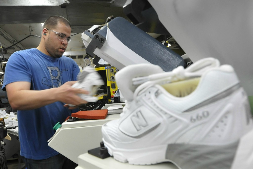 Staff Photo by Shawn Patrick Ouellette: Justin Waring lays souls on shoes at New Balance in Norridgewock Monday, May 9, 2011.