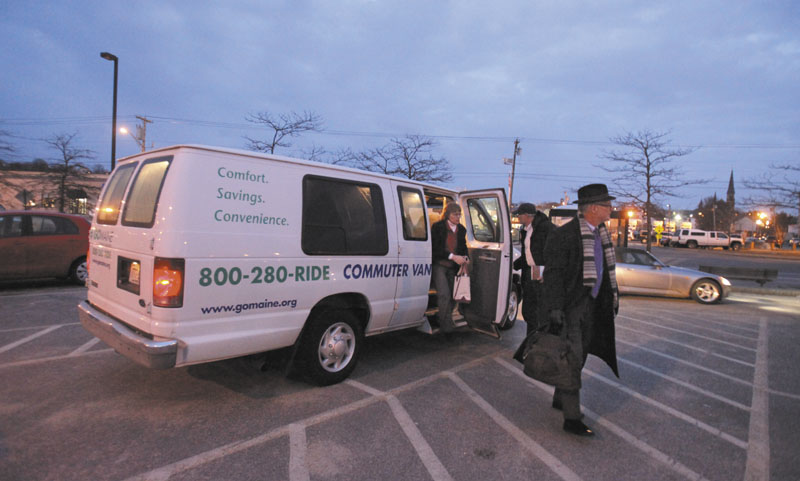 Commuters exit a van at the park and ride lot on Marginal Way in Portland last February. The state has been providing a van pool service since 2002 but is suspending the service and plans to turn it over to a private company in May.
