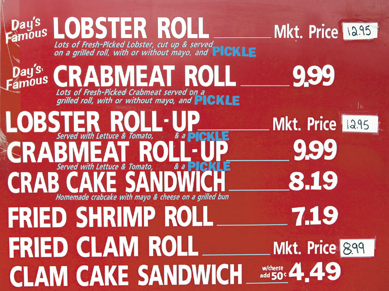 Prices on the menu board at Day's Take-Out in Yarmouth on Thursday.