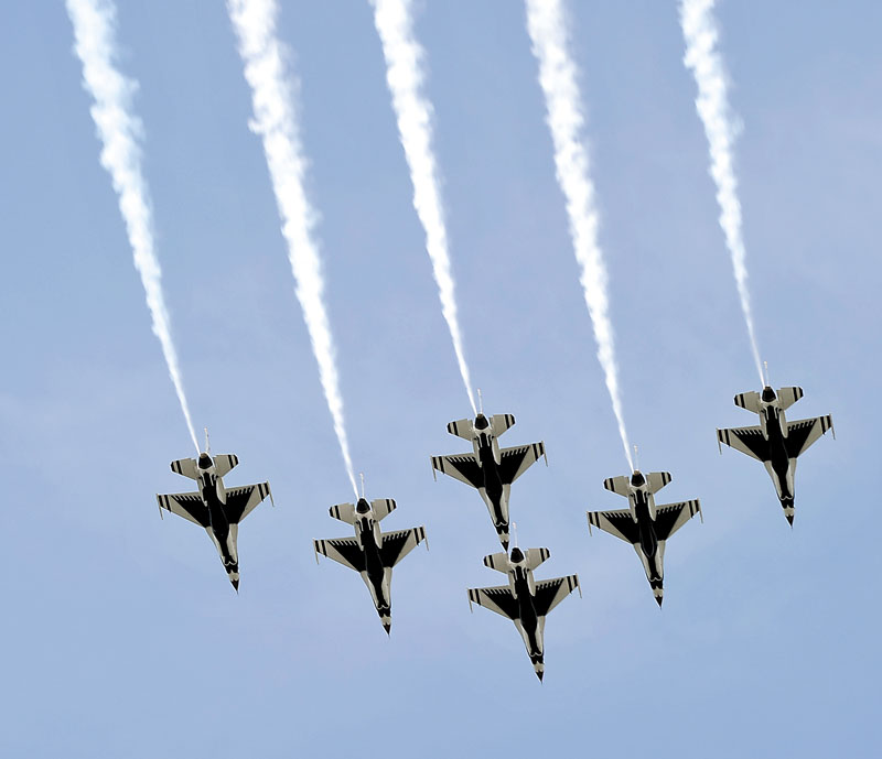 Five of the six United States Air Force Thunderbirds fly over local businesses on Thursday in a dress rehearsal of their part in the The Great State of Maine Air Show at the Brunswick Executive Airport.