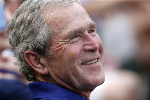 FILE - In this June 16, 2012 file photo, former President George W. Bush smiles as he takes in a baseball game in Arlington, Texas. The Rangers won 8-3. Sarah Palin and George W. Bush won�t be in Tampa. Hillary Rodham Clinton and Al Gore aren�t making the trip to Charlotte. And scores of other Republican and Democratic stars are taking a pass as their parties gather at every-four-years national conventions. The reasons are varied _ and political. (AP Photo/LM Otero, File)