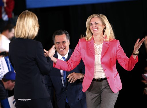 """FILE - In this March 6, 2012, file photo, Republican presidential candidate, former Massachusetts Gov. Mitt Romney, and his wife Ann arrive on stage as they are greeted by former Mass. Lt. Gov. Kerry Healey, at their Super Tuesday primary watch party in Boston. To the yearbook editors at the all-girl Kingswood School, Ann Lois Davies' destiny seemed pretty obvious. """"The first lady,"""" the entry beside the stunning blond beauty's photo in the 1967 edition of """"Woodwinds"""" concluded. """"Quiet and soft spoken."""" The modern feminist movement was just dawning, and even some of the girls at the staid prep school in the wealthy Detroit suburb of Bloomfield Hills were feeling their oats _ if in a somewhat tame way. Charlon McMath Hibbard remembers getting a doctor's note about her feet, so she wouldn't have to wear the obligatory saddle Oxfords. (AP Photo/Gerald Herbert, File)"""