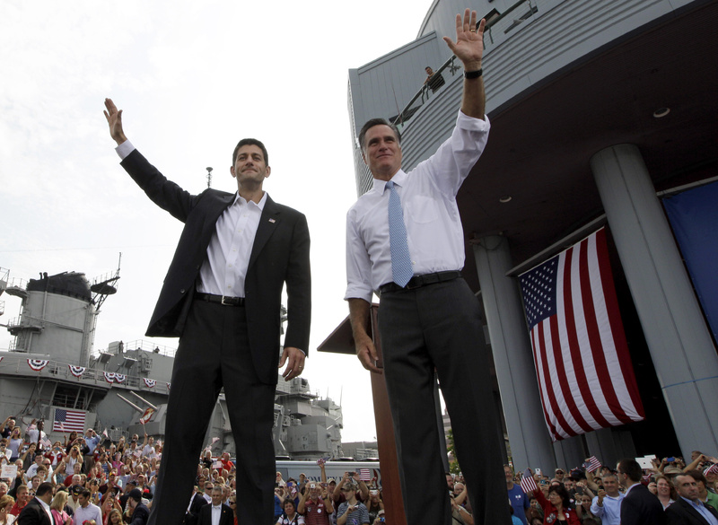 Republican presidential candidate Mitt Romney, right, and vice presidential candidate Wisconsin Rep. Paul Ryan, R-Wis., wave at the crowd during a campaign event Saturday in Norfolk, Va., where Romney introduced Ryan as his running mate.
