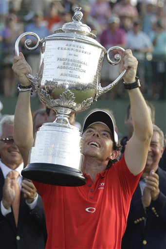 Rory McIlroy of Northern Ireland holds up the championship trophy after the final round of the PGA Championship golf tournament on the Ocean Course of the Kiawah Island Golf Resort in Kiawah Island, S.C., Sunday, Aug. 12, 2012. (AP Photo/Chuck Burton)