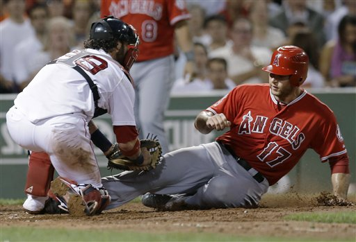 Los Angeles Angels' Chris Iannetta (17) is tagged out by Boston Red Sox catcher Jarrod Saltalamacchia as he tries to score on an infield grounder by Vernon Wells in the fifth inning of a baseball game at Fenway Park in Boston on Wednesday.