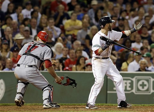 Boston Red Sox's Dustin Pedroia waves in Scott Podsednik to score from third as Los Angeles Angels catcher Chris Iannetta (17) chases down a wild pitch during the seventh inning of a baseball game in Boston Tuesday, Aug. 21, 2012. (AP Photo/Elise Amendola)
