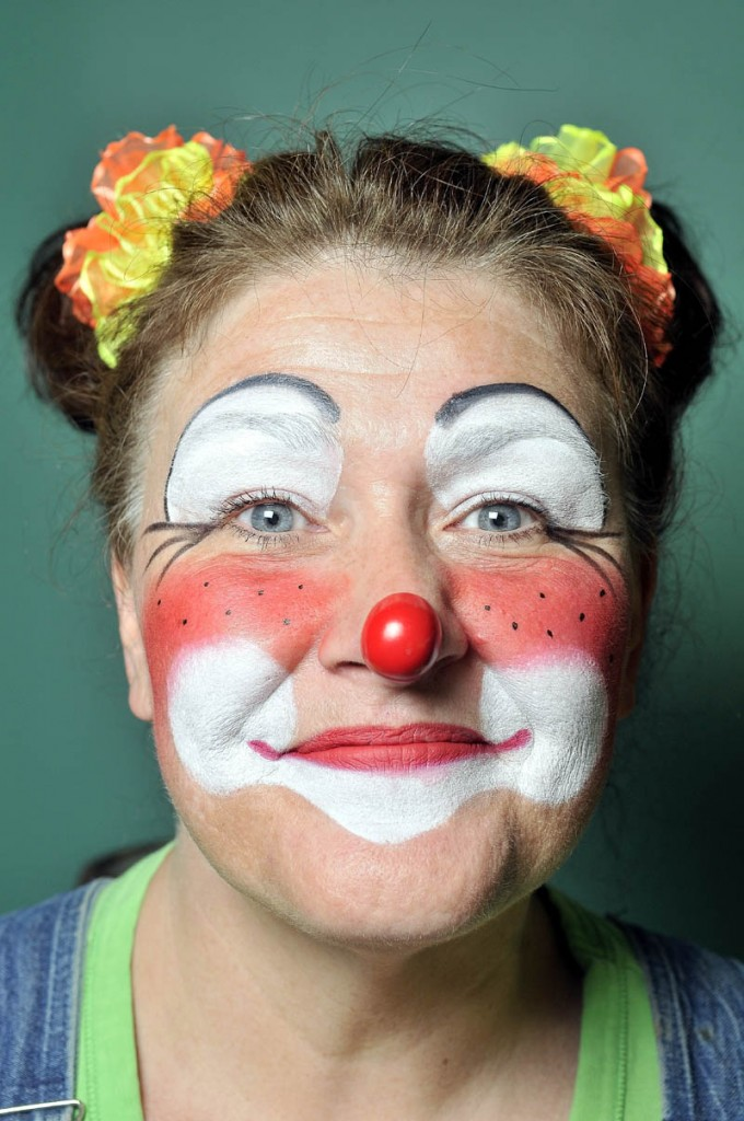 Anotonia Smith of Oakland, a.k.a Wingnut the Clown, shows off her clown visage.