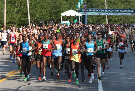 Runners leave the start line Saturday, Aug. 4, 2012, during the annual TD Bank Beach To Beacon 10K road race in Cape Elizabeth, Maine. (AP Photo/Joel Page)
