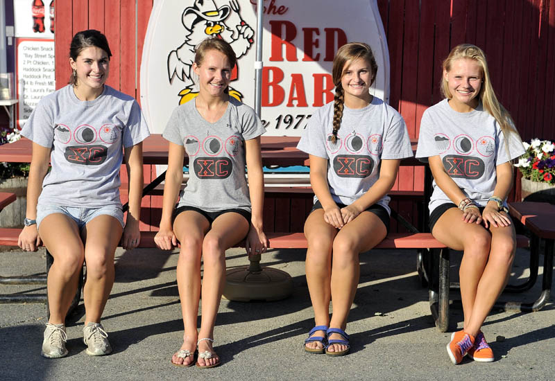 Staff Photo by Michael G. Seamans From left to right, Riley Jones, 18, Lauren Schassberger, 18, Audrey Jones, 16, and Molly Schassberger,17, pose for a portrait at the Red Barn in Winslow. The two sets of sisters will be running the Beach to Beacon.