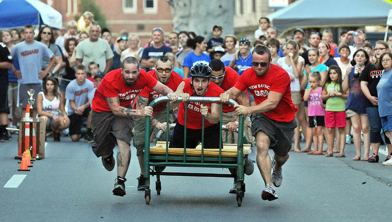 Staff photo by Michael G. Seamans Team N-Walk races in the Great Skowhegan Bed Races sponsored by the Parks and Recreation Department in downtown Skowhegan Thursday evening.