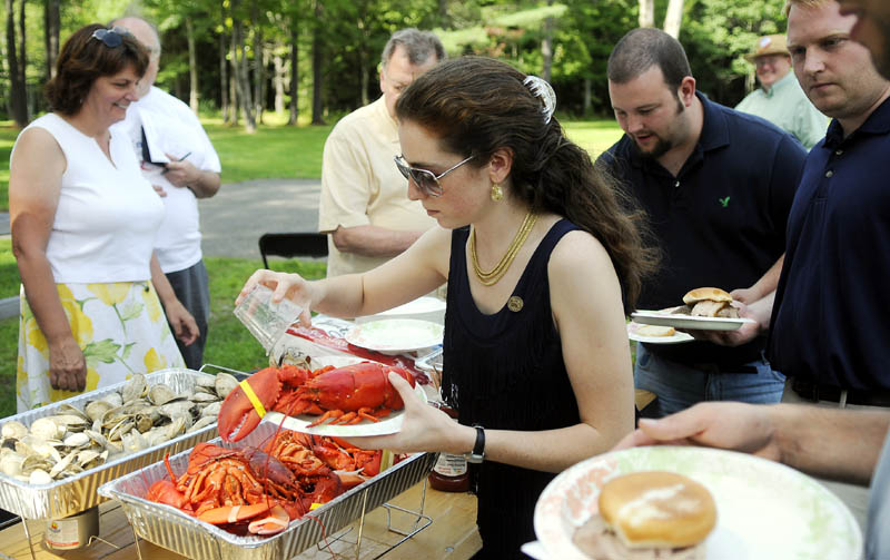 Ashley Ryan, of South Portland, the National Committeewoman Elect for the Maine Republican Party, scoops up clams Sunday during the Maine Liberty Caucus' 3rd annual Calvin Coolidge Clambake in Sidney.