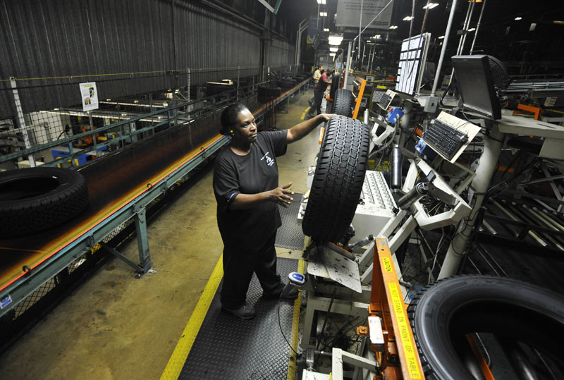 Tire inspector Flora Roundtree checks a tire for defects July 24, at a Michelin manufacturing plant in Greenville, S.C., which produces about 25,000 tires a day. The U.S. economy generated 163,000 jobs in July after three months of weak hiring.