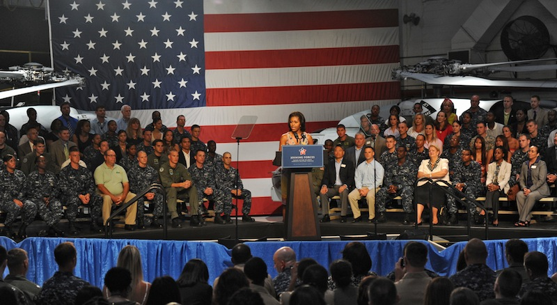 First Lady Michelle Obama visits the Mayport Naval Station in Jacksonville, Fla., Wednesday, Aug. 22, 2012. The first lady chose a naval station in the electoral battleground of Florida to announce that 2,000 businesses around the country have hired or trained more than 125,000 military veterans and spouses in the past year, exceeding a White House goal of 100,000 by the end of next year. (AP Photo/The Florida Times-Union, Bob Mack)