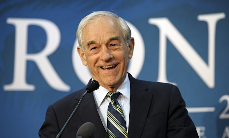 In this March 28, 2012, file photo, Republican presidential candidate Rep. Ron Paul, R-Texas, appears at a town hall meeting in College Park, Md. Paul picked up more delegates to the Republican National Convention Tuesday, Aug. 21, 2012, after his supporters reached a compromise over disputed delegates from Louisiana. Paul will get 17 of the Louisiana's 46 delegates in the compromise, said Charlie Davis, who served as Paul's campaign chairman in Louisiana. The rest of the state's delegates are expected to support Mitt Romney, the party's presumptive nominee. (AP Photo/Cliff Owen, File)