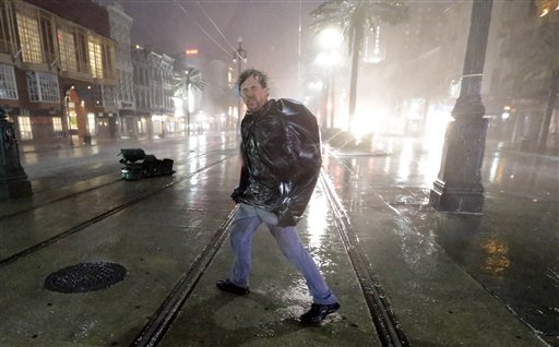A man crosses Canal Street in the wind and rain from Hurricane Isaac Wednesday, Aug. 29, 2012, in New Orleans. (AP Photo/David J. Phillip)