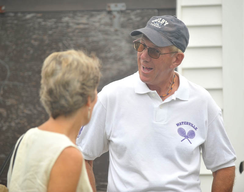 Waterville Senior High School tennis coach Jim Begin talks to Sue Cook of Waterville before the North Street tennis court were renamed the Jim Begin Recreational Tennis Courts on Friday.