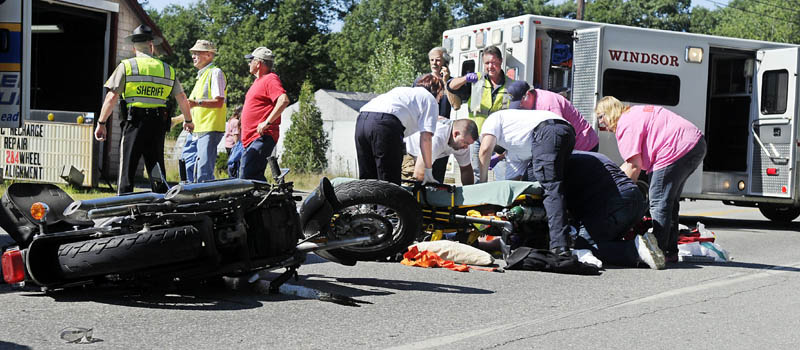 BIKE ACCIDENT: Medics attend to a man who was injured Monday morning after falling off a motorcycle on Route 17 in Windsor. The victim was flown by helicopter to a hospital for treatment.