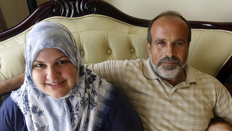 In this 2009 photo, Abdulrahman Zeitoun and his wife, Kathy, pose for a photo in their Broadmoor home in New Orleans. Abdulrahman Zeitoun, who paddled his canoe through the eerily quiet flooded landscape of New Orleans helping people and animals after Hurricane Katrina, has been accused of trying to hire someone to murder his now ex-wife, her son and another man. (AP Photo/The Times-Picayune, Michael DeMocker)