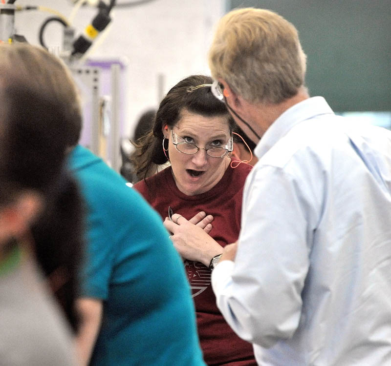 Vanessa Bolstridge, a seven-year veteran employee at New Balance, reacts to Senate candidate and former governor Angus King, right, during a campaign tour of the Skowhegan factory Tuesday.