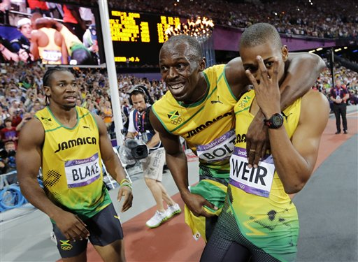 Jamaica's Usain Bolt, center, Jamaica's Yohan Blake, left, and Jamaica's Warren Weir celebrate their medals in the men's 200-meter final during the athletics in the Olympic Stadium at the 2012 Summer Olympics, London, Thursday, Aug. 9, 2012. Bolt won gold, Blake silver and Weir bronze. (AP Photo/David J. Phillip) 2012 London Olympic Games Summer Olympic games Olympic games Sports Events XXX Olympiad