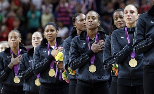 Members of the United States women's basketball team stand for the national anthem after receiving their gold medals following their win over France in the gold medal basketball game at the 2012 Summer Olympics, Saturday, Aug. 11, 2012, in London. (AP Photo/Eric Gay) 2012 London Olympic Games Summer Olympic games Olympic games Sports Events XXX Olympiad