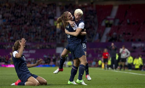United States' Megan Rapinoe, right, celebrates with teammate Alex Morgan as Tobin Heath slides in on her knees after scoring against Canada during their semifinal women's soccer match at the 2012 London Summer Olympics, Monday, Aug. 6, 2012, at Old Trafford Stadium in Manchester, England. (AP Photo/Jon Super) 2012 London Olympic Games
