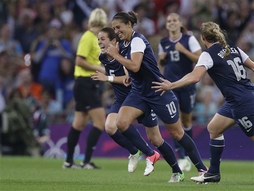 United States' Carli Lloyd (10) celebrates her goal with teammates during the women's soccer gold medal match against Japan at the 2012 Summer Olympics, Thursday, Aug. 9, 2012, in London. (AP Photo/Julie Jacobson) 2012 London Olympic Games Summer Olympic games Olympic games Sports Events XXX Olympiad