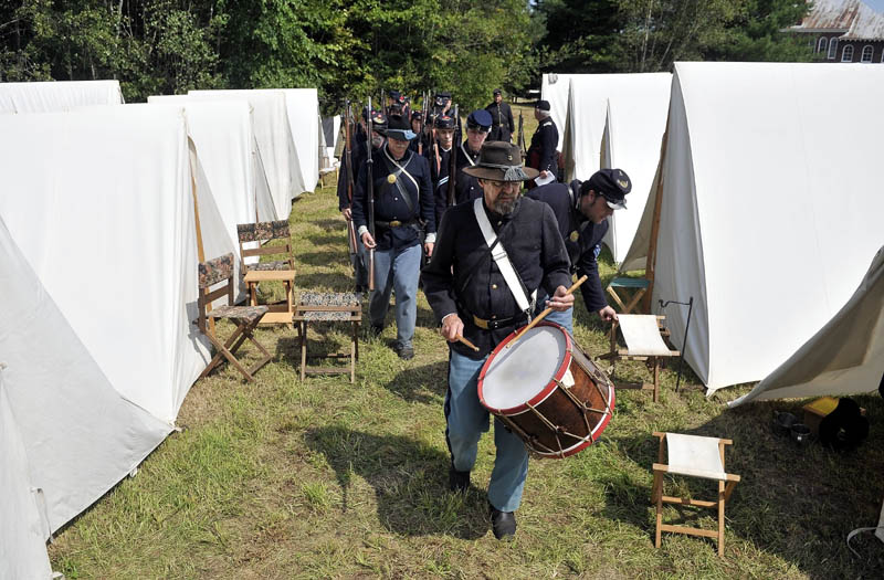Staff photo by Michael G. Seamans The 20th Maine Regiment marches into their Civil-War era encapment during a Civil War re-enactment at Good Will-Hinkley in Fairfield Saturday. Events continue today and are open to the public from 9 a.m. to 2 p.m. A $5 donation is suggested.