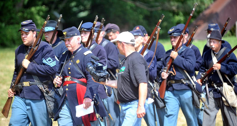 Maine Public Broadcasting Network films the 20th Maine Regiment during a Civil War re-enactment at Good Will-Hinkley in Fairfield Saturday. Events continue today and are open to the public from 9 a.m. to 2 p.m. A $5 donation is suggested.