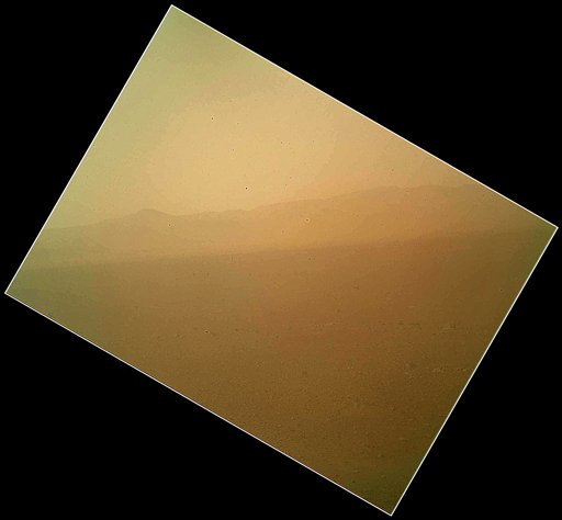 This image released today by NASA shows the first color view of the north wall and rim of Gale Crater where NASA's rover Curiosity landed Sunday night. The picture was taken by the rover's camera at the end of its stowed robotic arm and appears fuzzy because of dust on the camera's cover.