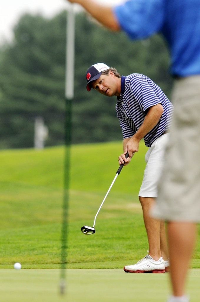 ON TARGET: Jason Gall putts Wednesday during the second round of the Maine State Golf Association Match Play tournament at Natanis Golf Course in Vassalboro.