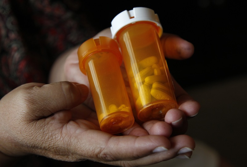 Sandra Pico, 52, holds medications she takes, at her home in North Miami Beach, Fla., Thursday, July 26, 2012. Pico makes about $15,000 a year working about 20 hours a week as a home health aide, a bit too much to qualify for Medicaid, but not enough that she can afford private insurance. She thought she'd be getting health insurance after the Supreme Court upheld the health care law. Then she learned her own governor won't agree to expand Medicaid under the law which would have given her coverage. (AP Photo/Lynne Sladky)