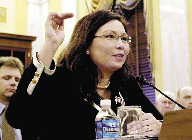 In this April 1, 2009 photo, then-Assistant Veterans Affairs Secretary-designate Tammy Duckworth testifies on Capitol Hill in Washington. After more than a decade of wars in Iraq and Afghanistan, dozens of military veterans — Republicans and Democrats — are running for Congress this election year as voters have shown a fresh enthusiasm for candidates with no elected experience. This year, as the military has opened more jobs to women closer to the front lines, several of those veterans are females with battlefield scars and pioneering accomplishments.