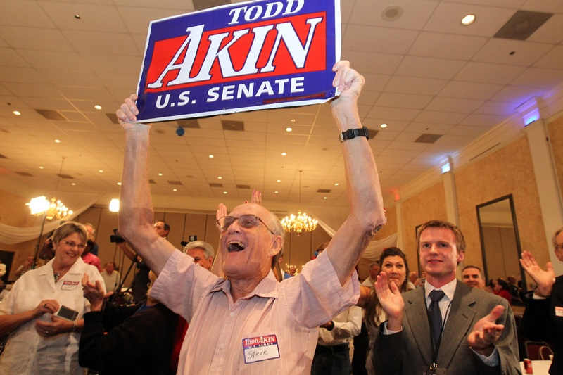 Steve Holloway of Lincoln County, Mo., celebrates word that U.S. Senate candidate Todd Akin won the GOP primary at a campaign party in St. Charles, Mo., on Tuesday. campaign;Lincoln County;Missouri;politics;primary;Republican Party;Steve Holloway;todd akin;United States Senate;us senate