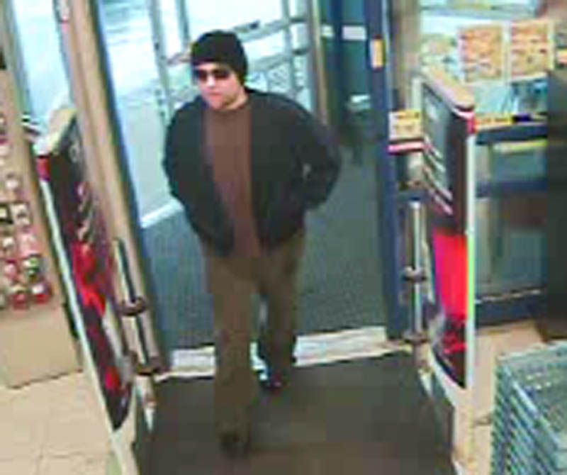 Police are looking for the man in this security camera photo who robbed the Rite Aid pharmacy of drugs in Newport Thursday evening.