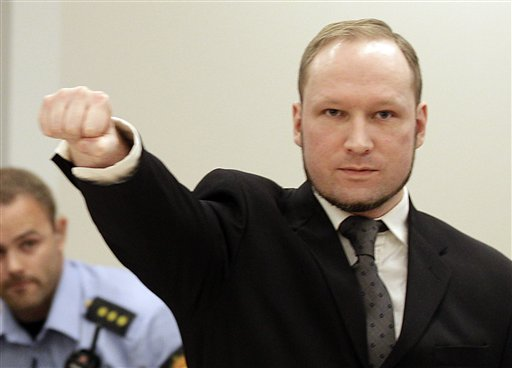 Mass murderer Anders Behring Breivik, makes a salute after he arrives at the courthouse in Oslo today.